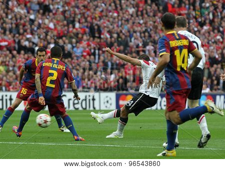 LONDON, ENGLAND. May 28 2011: Barcelona's Sergio Busquets and Daniel Alves and Javier Hernndez during the 2011UEFA Champions League final between Manchester United and FC Barcelona