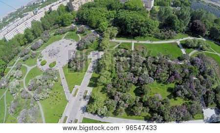 Lilac Garden with people at spring sunny day in Moscow. Aerial view