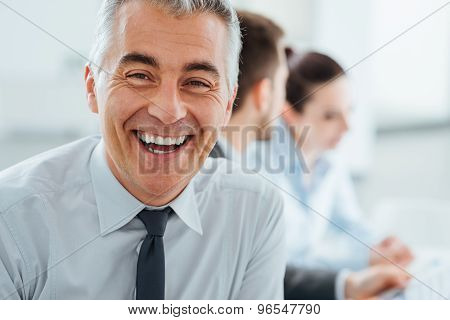 Confident Smiling Businessman Posing
