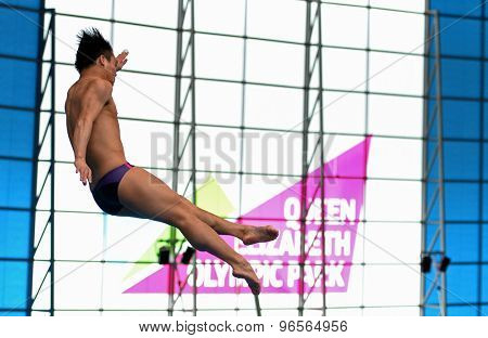 LONDON, GREAT BRITAIN - APRIL 26 2015: Chong He of China competing in the men's 3m springboard during the FINA/NVC Diving World Series at the London Aquatics Centre