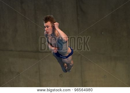 LONDON, GREAT BRITAIN - APRIL 26 2015: Jack Laugher of Great Britain competing in the men's 3m springboard during the FINA/NVC Diving World Series at the London Aquatics Centre
