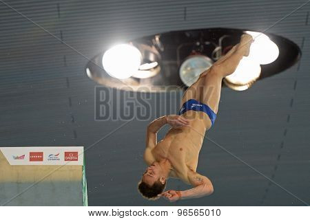 LONDON, GREAT BRITAIN - APRIL 25 2015: Tom Daley of Great Britain diving in a training session during the FINA/NVC Diving World Series at the London Aquatics Centre