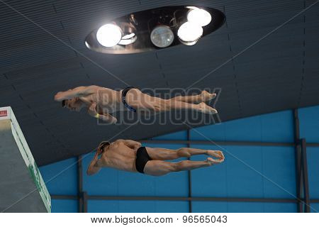 LONDON, GREAT BRITAIN - APRIL 25 2015: Stephan Feck and Patrick Hausding of Germany competing in the men's synchro 10m platform during the FINA/NVC Diving World Series at the London Aquatics Centre