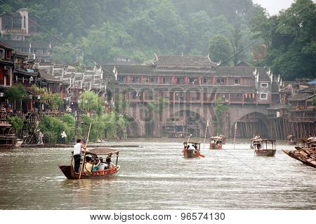 Tourists Relax, Take A Boat Trip On The River In Fenghuang Ancient City.