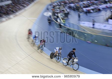 LONDON, ENGLAND. FEBRUARY 18 2012: A general slow shutter shot of the mens Keirin at the UCI Track Cycling World Cup at the London Velodrome, Queen Elizabeth 2nd Park