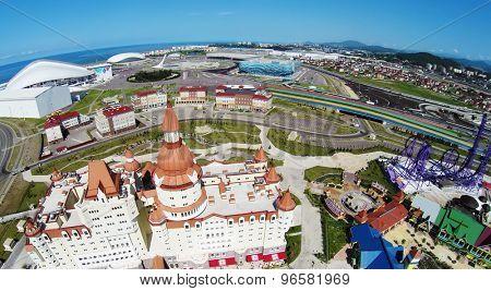 RUSSIA, SOCHI - JUL 29, 2014: Bogatyr hotel complex near amusement park and Olimpic stadium. Aerial view. Photo with noise from action camera.