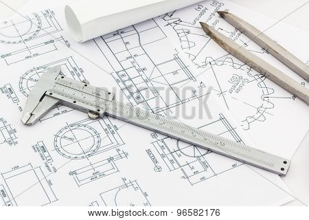 Engineering Dividers Tools And Vernier Scale On Blueprint Background.