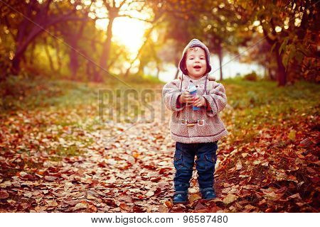 Happy Kid Laughing And Walking In The Park