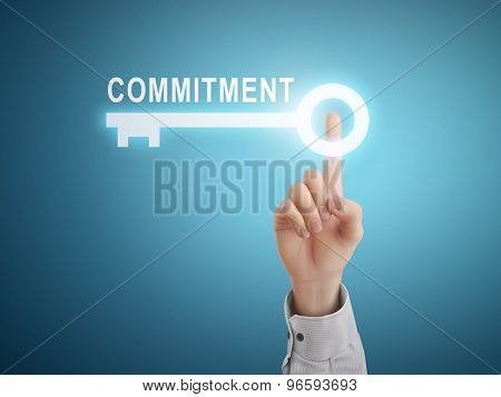 Male Hand Pressing Commitment Key Button