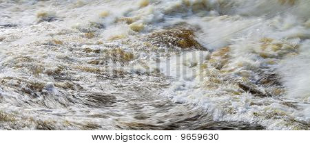Detail Of A Tumultuous Brown Canadian River