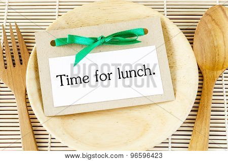 Time for lunch in card on wooden dish and spoon poster