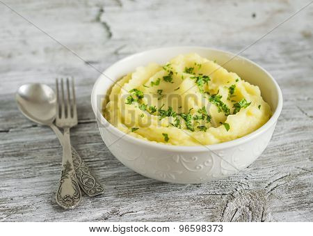 Mashed Potatoes In A White Bowl On A Light Wooden Background