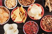 Tortilla chips and other salty snacks with homemade salsa poster
