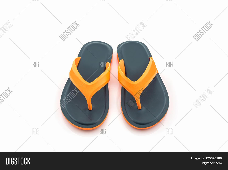 d20da9ff0886 Colorful of Sandals shoes   Orange and black flip flops on white background.