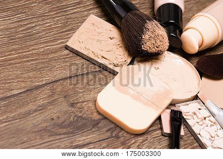 Make up products for flawless complexion: foundation, concealer, powder with cosmetic sponge and professional makeup brushes. Selective focus, copy space