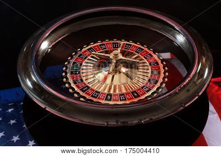 American flag and its reflection in the roulette wheel