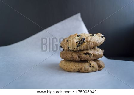 Homemade Cookies With Raisins On A Black Background
