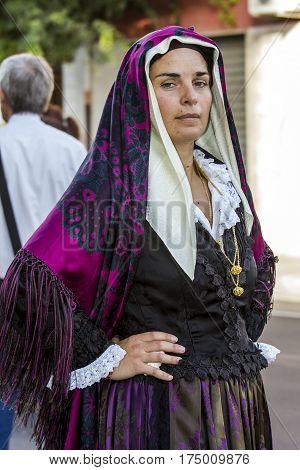 SELARGIUS, ITALY - September 13, 2015: Former marriage Selargino - portrait of a woman in traditional Sardinian costume folk group Santu Iacu Mandas - Sardinia