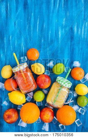 Citrus Vitamin Juice With Fresh Fruits Around