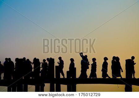 Silhouette of Traveler on the U penn bridge while Sunset.