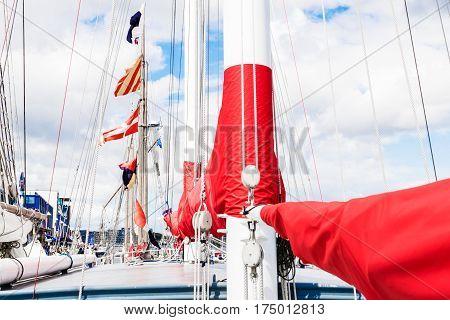 Sailing ship rigging detail. Mast, sails and shroud of a tall ship.