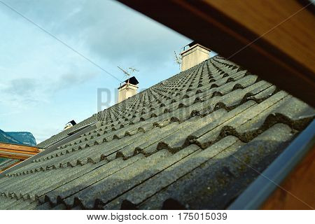 Roof window view on gray Slate tiles