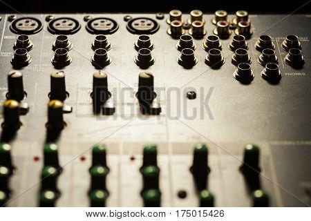 Close up shot of some input plugs on a audio mixer.