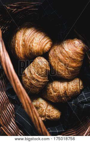 Fresh croissants, french rolls. Closeup view, selective focus