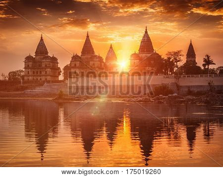 View of Royal cenotaphs of Orchha over Betwa river. Orchha, Madhya Pradesh, India. With lens flare and light leak