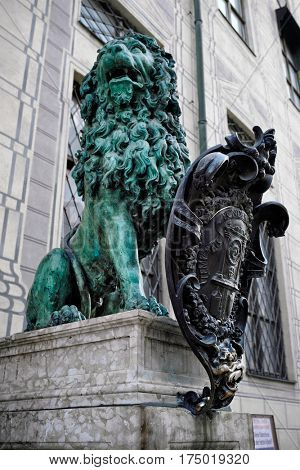 Bavarian lion statue at Munich Alte Residenz palace in Odeonplatz. Munich, Bavaria, Germany