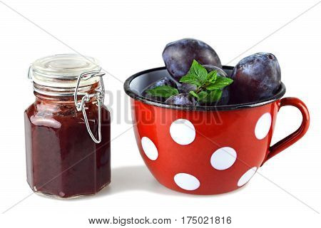 Plum jam jar and fresh plums in the cup