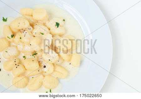 potato gnocchi with fontina cream from italy