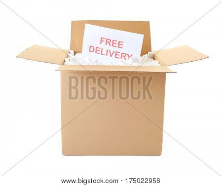 Card with text FREE DELIVERY in open carton box on white background