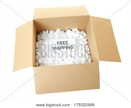 Card with text FREE SHIPPING in open carton box on white background