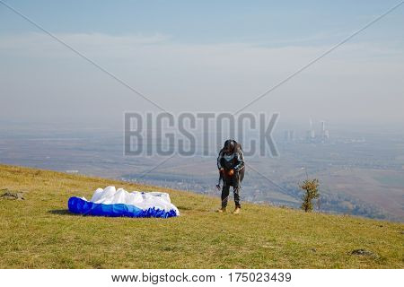 ABASAR, HUNGARY - 22 OCTOBER, 2014: Paraglider about to take off from Sarhegy, which is an ideal location for practice