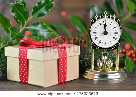 Midnight clock and gift box with red ribbon