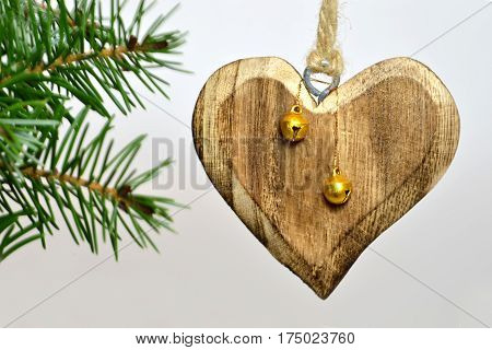 Christmas card: Wooden heart and jingle bells