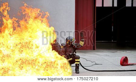 brave firefighters during the exercise for the fire extinguishing caused by a leakage of liquid gas