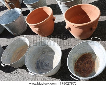 Aluminum Buckets And Clay Pots For Sale At The Market