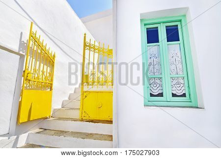 traditional architecture Sifnos island Cyclades Greece - yellow door and green window