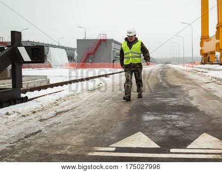 CHERNOBYL UKRAINE - December 2016: Worker of the Chernobyl nuclear power plant is near spent nuclear fuel storage