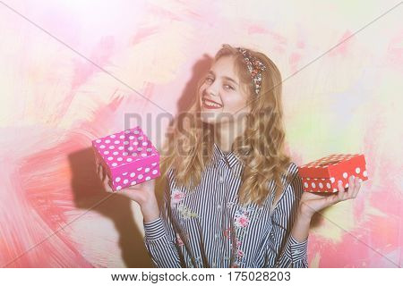 Cheerful Girl With Two Red And Pink Polkadot Gift Boxes