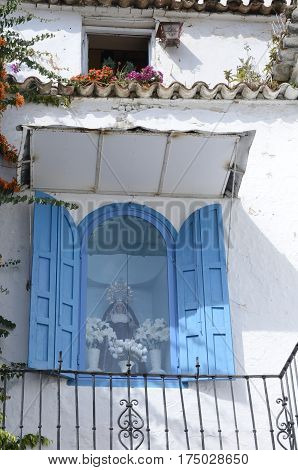 MARBELLA, SPAIN - FEBRUARY 27, 2017: Statue of the Virgin Mary on balcony in restaurant located in the old town of Marbella Andalusia Spain.
