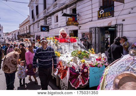 Sucre, Bolivia on September 8, 2015: Street parade with decorated cars to celebrate the Virgin of Guadalupe