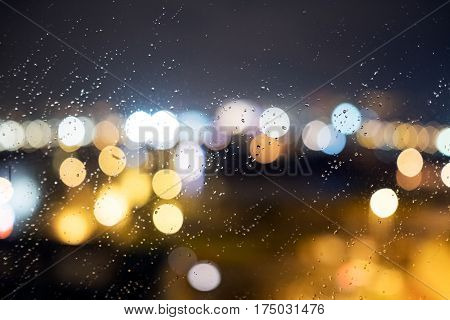 Drops Of Rain And Lights On The Window (glass) At The Night. Shallow Dof