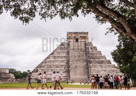 Chichen Itza, Yucatan, Mexico on December 18, 2015: Tourists at Chichen Itza, one of the most visited archaeological sites in Mexico.