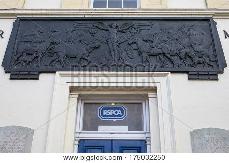 LONDON UK - 16TH FEBRUARY 2017: An embossed plaque on the facade of the Animal War Memorial Dispensary in Kilburn London on 16th February 2017.