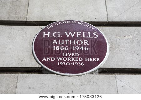 LONDON UK - FEBRUARY 16TH 2017: A plaque on Baker Street in London marking the location where famous author HG Wells lived and worked taken on 16th February 2017.