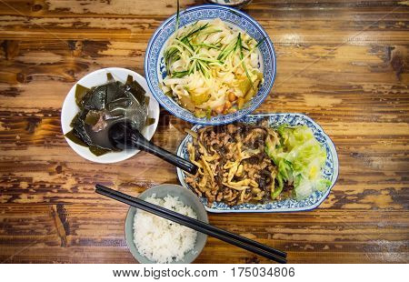 Noodles, Kelp Soup And Sliced Pork Fried With Vegetables