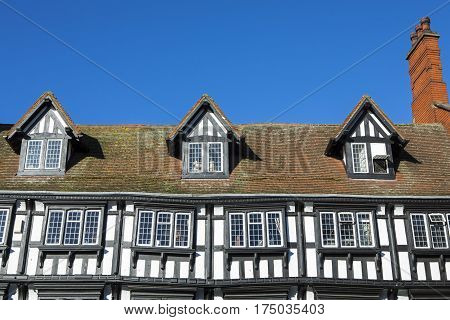 A view of the Tudor exterior of one of the many traditional buildings in the historic city of Lincoln in the UK.